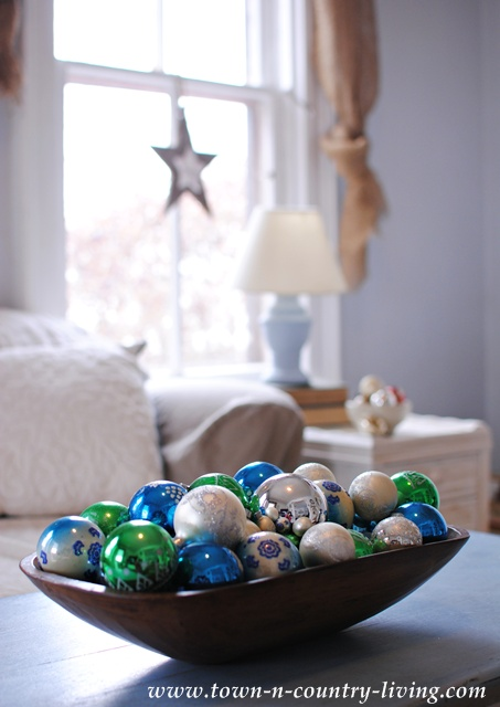 Dough bowl filled with vintage glass ornaments