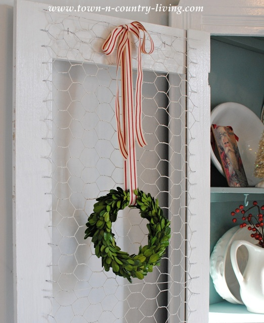 Boxwood wreath with peppermint stripe ribbon
