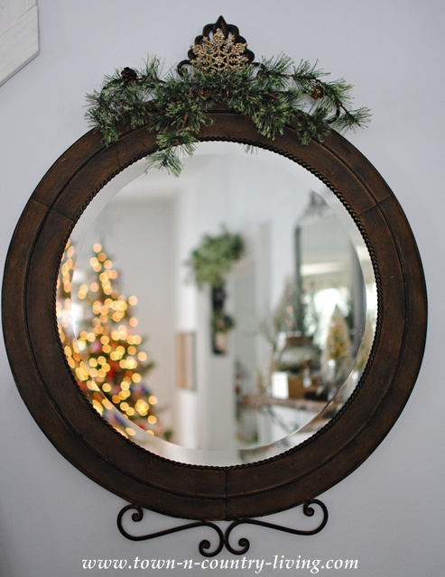 Reflections of Christmas in a living room mirror