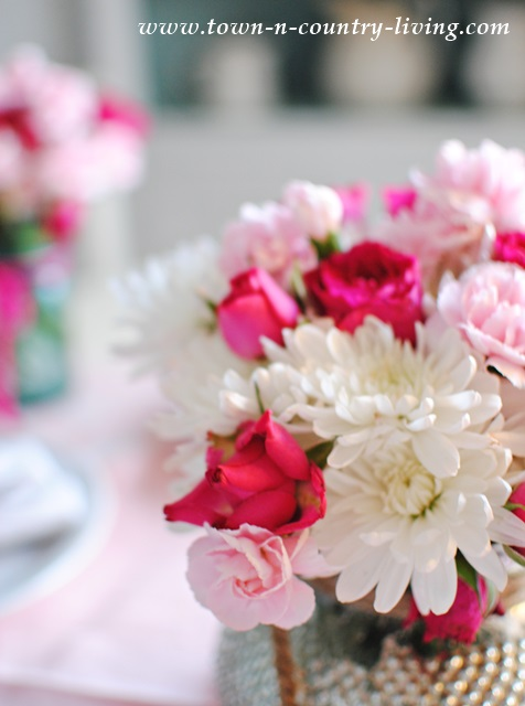 White mums, pink carnations and roses for dining centerpiece