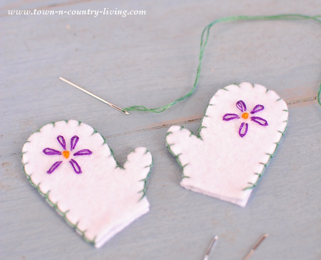 Embroidering mini felt mittens