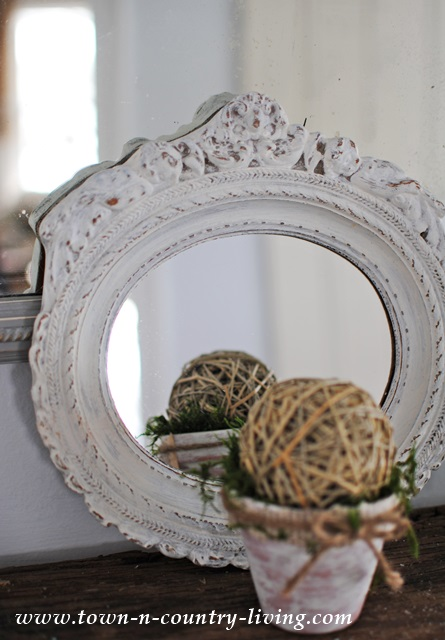 White vintage mirror via Town and Country Living
