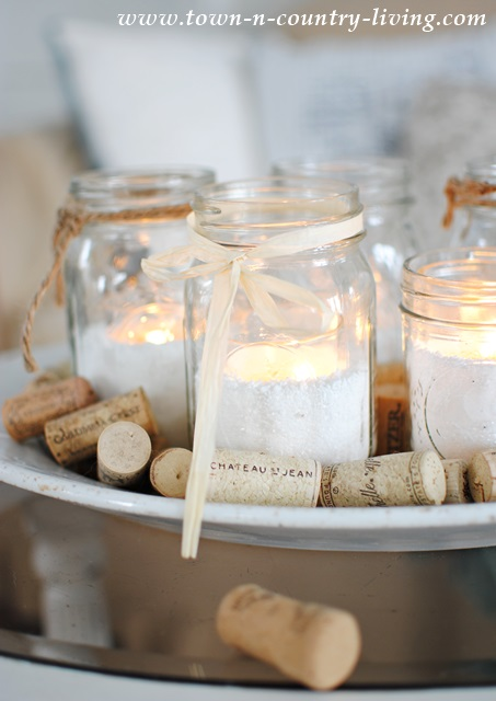 Mason jar candles with raffia and twine bows