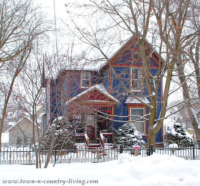 Blue clapboard Victorian home in Woodstock, IL