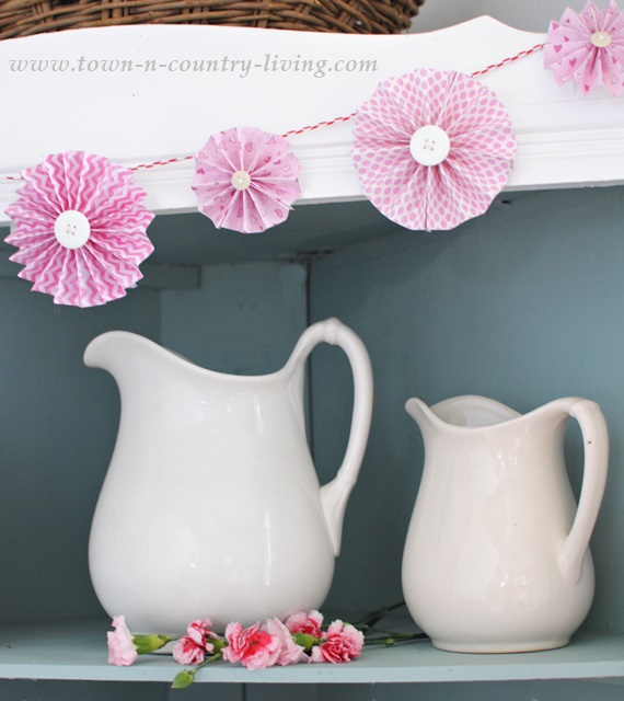 White ironstone and pink carnations in a farmhouse hutch
