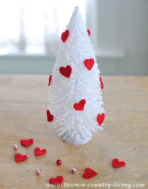 Glue red felt hearts to bottle brush trees