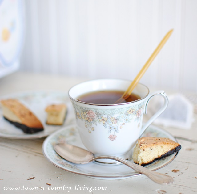 Honey stick with cup of tea