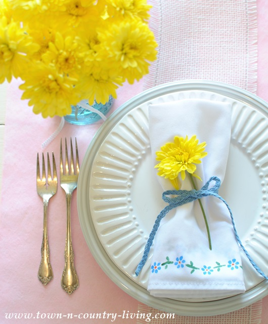 Spring table setting with stenciled napkins