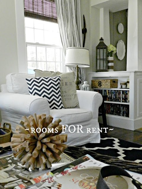 Soft slipcovers mix with other textures in a rustic cottage style living room