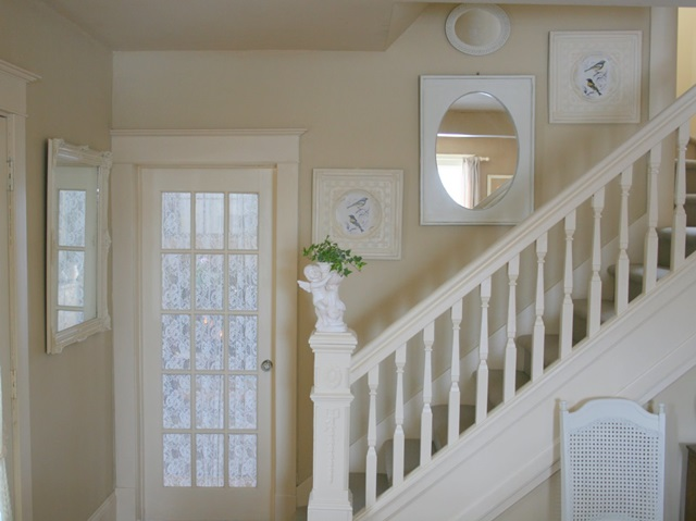 Traditional white stairway in charming older home