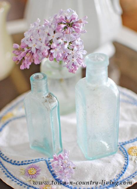 Lilacs in Vintage Aqua Bottle