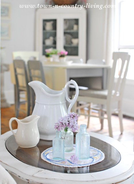 Lilacs with Vintage Bottles and White Ironstone Pitchers