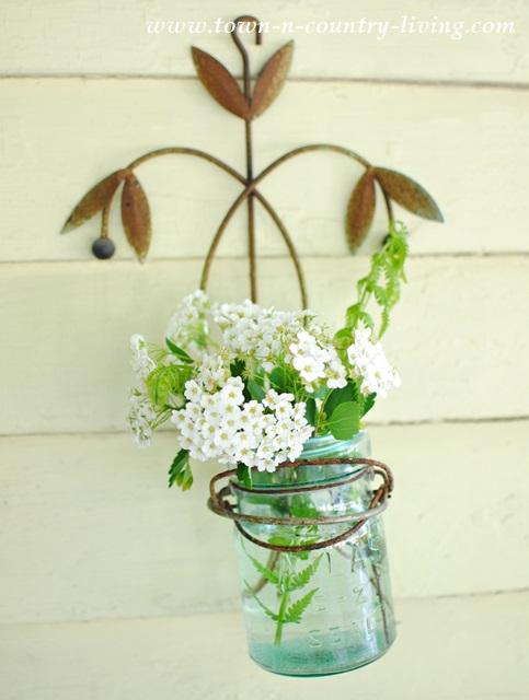 Vintage Blue Atlas Jar with Bridal Wreath Flowers