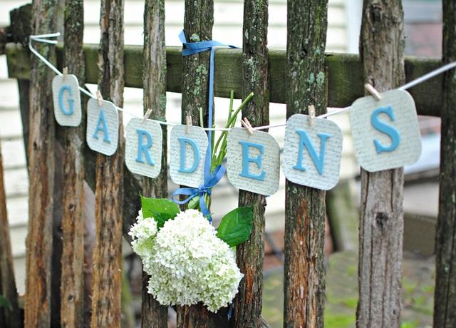 DIY Garden Banner on Rustic Fence