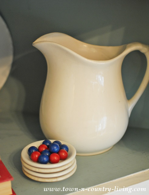 Ironstone Pitcher with Red and Blue Wooden Marbles