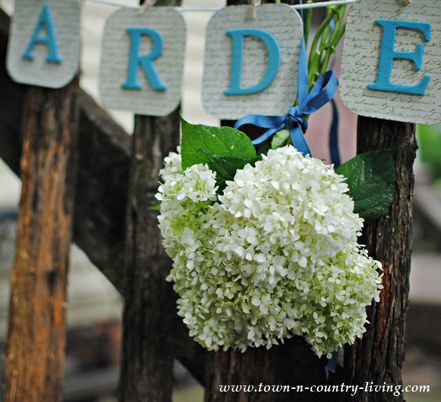 Rustic Picket Fence with Simple Garden Banner