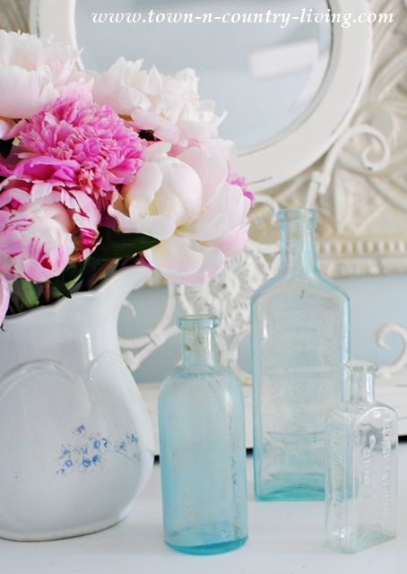 Vignette with Pink Peonies and Aqua Bottles
