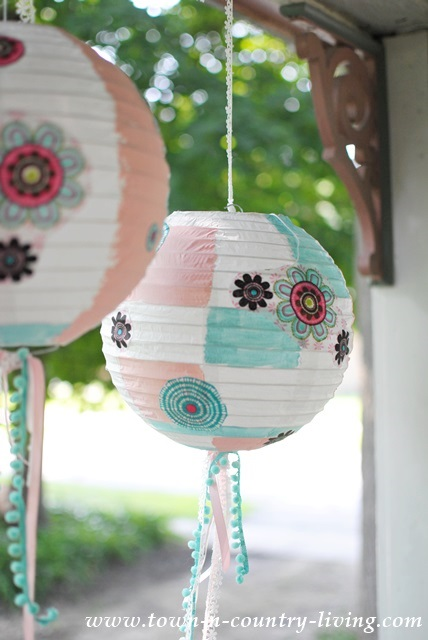 Decorate paper lanterns with fabric, paint and ribbons