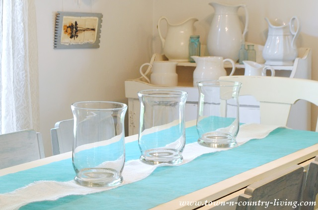 Glass Hurricanes to use as candle holders in centerpiece