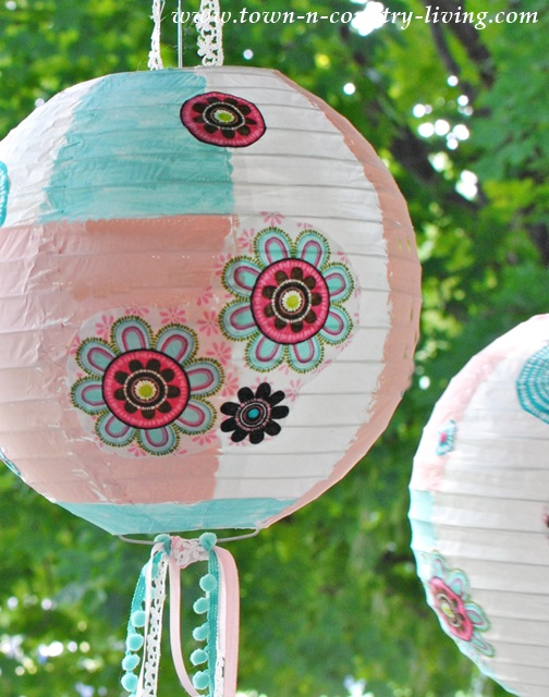 Paper Lanterns decorated with fabric, acrylic paint, and ribbons