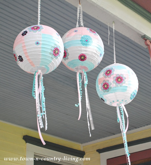 Festive Paper Lanterns decorated with paint, fabric, and ribbons