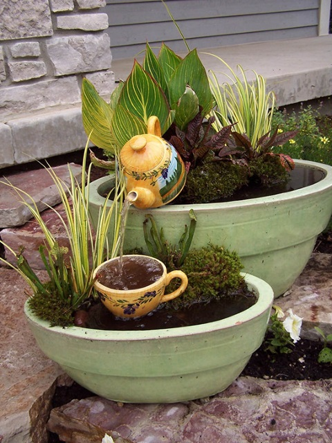 Overflowing Teapot Container Water Garden