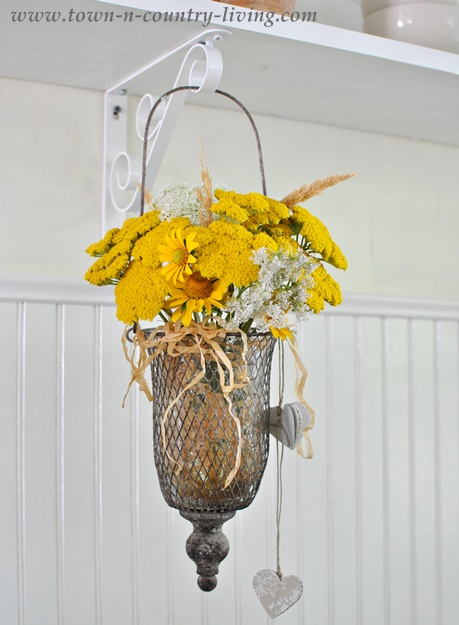Yellow and White Wildflowers in Hanging Vase