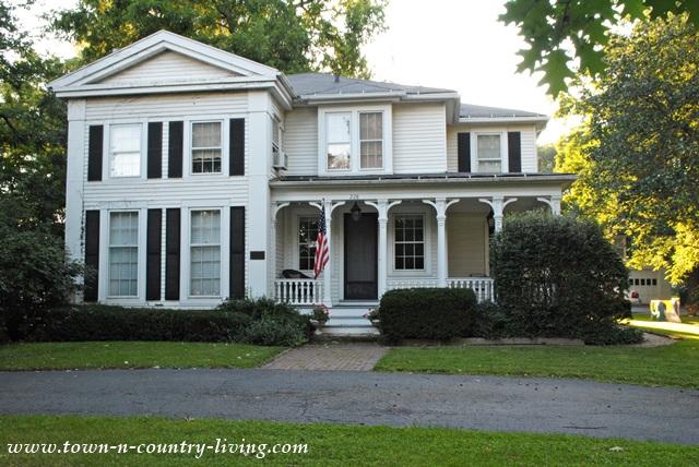 Classic White Farmhouse with Large Porch in Geneva Illinois