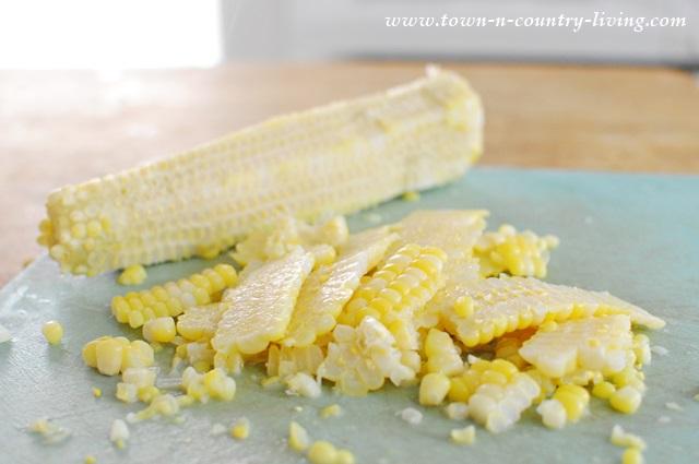 Cut corn kernels off cob before freezing