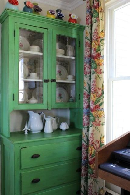Green farmhouse kitchen cabinet