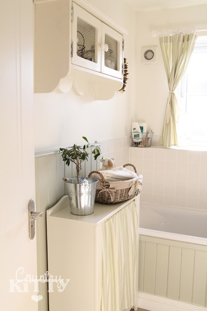 Light and airy country style bathroom