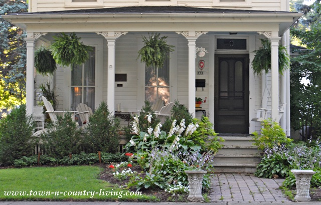 Front Porch with Hanging Ferns and Adirondack Chairs for Enjoying Summer Days