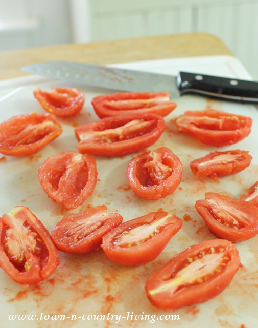 Remove seeds from peeled tomatoes to prepare them for canning