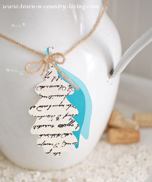 Paper Leaves Tied with Twine around Enamelware Pitcher