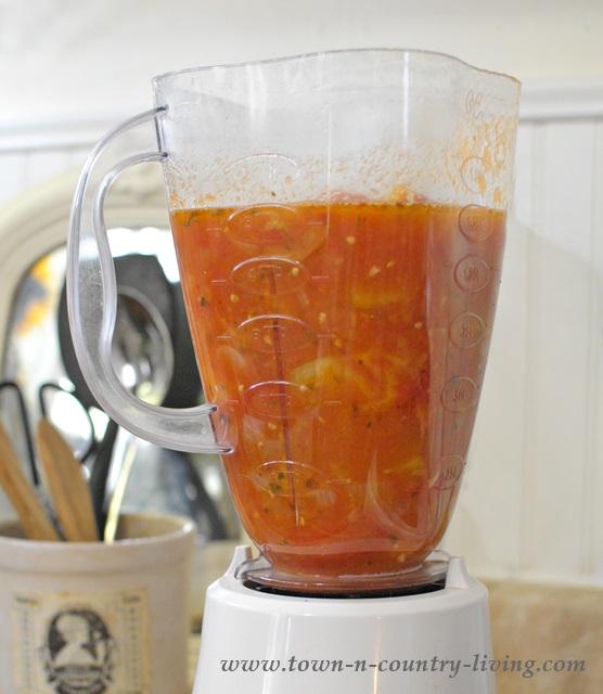 Puree tomatoes to make homemade tomato sauce