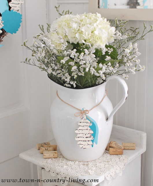 Simple Early Fall Vignette with Enamelware Pitcher of Flowers and Paper Leaf Adornment