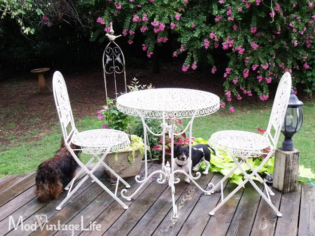 Outdoor deck with white ice cream parlor set
