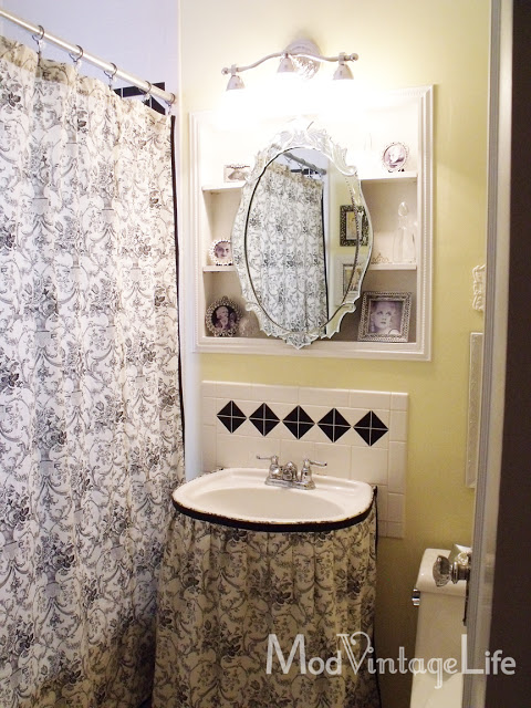 Master bathroom with black and white toile