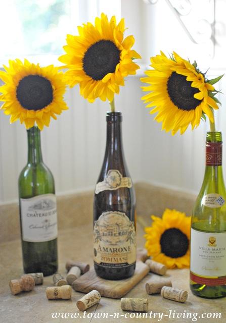 Simple Sunflowers Arranged in Wine Bottles