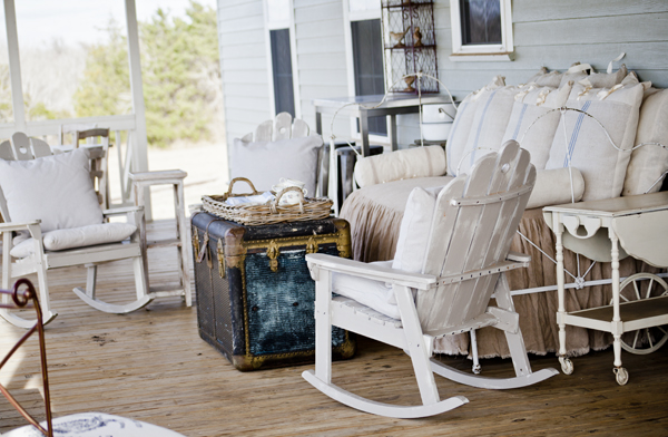 Back porch seating area with vintage iron daybed