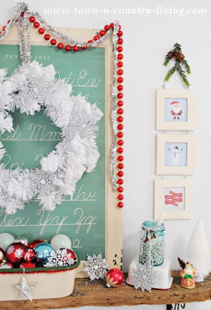 Whimsical Christmas Mantel. Free printables available to create the cute, framed prints.