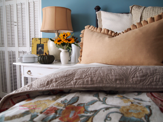 Home Decorating. Blue walls in a master bedroom with soft bedding.