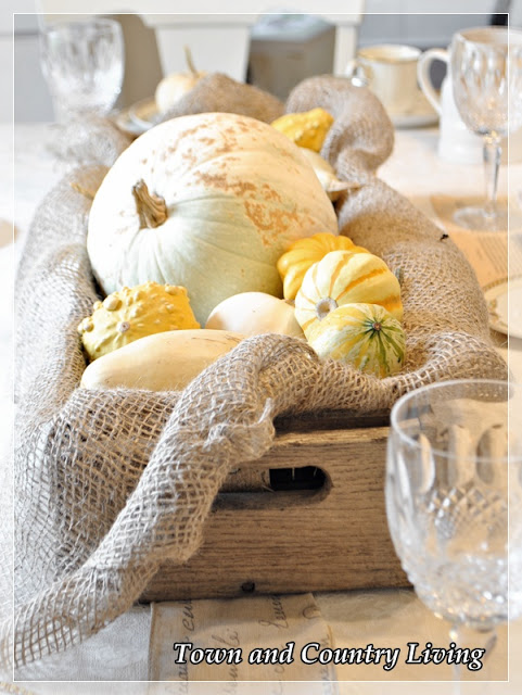 Holiday Decor - Thanksgiving Centerpiece features gourds in an old drawer lined with landscape burlap