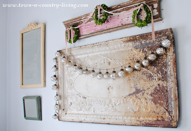 Vintage Ceiling Tin and Architectural Mantel Provide Wall Art