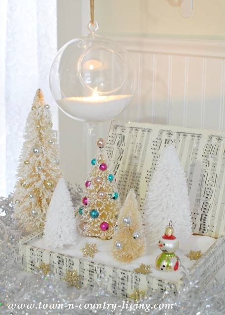 DIY Christmas Decor. Snowy bottle brush scene in a cigar box.