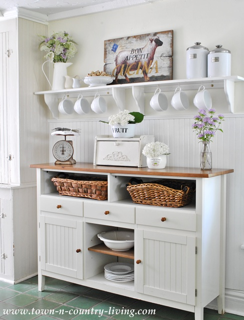 Elements of Farmhouse Style - freestanding pieces in the kitchen as opposed to walls of cabinetry.