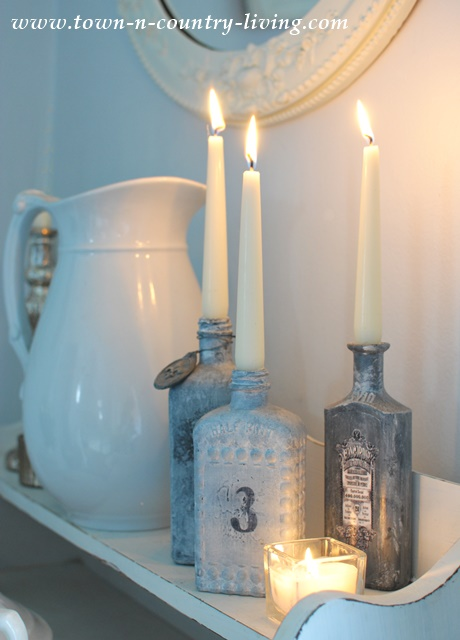 Gray Painted Bottles become candle holders.