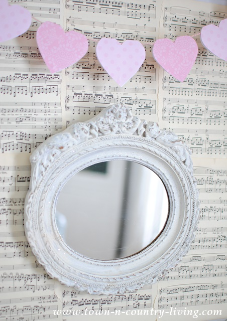 Paper Heart Banner hangs above a vintage shabby mirror