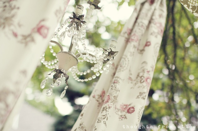 Party Chandelier and Pink Print Curtains