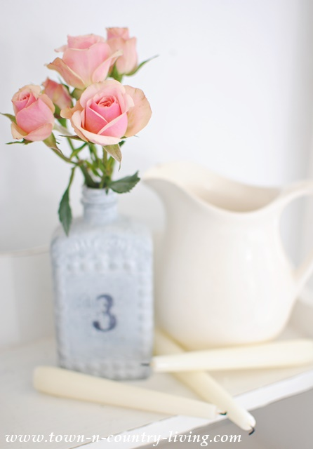Rose spray in a gray numbered bottle